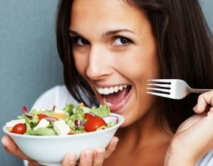 Woman showing off her salad